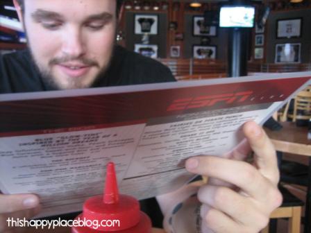 James looking at a menu at ESPN