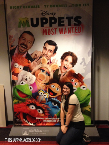Estelle in front of the Muppets Most Wanted Poster
